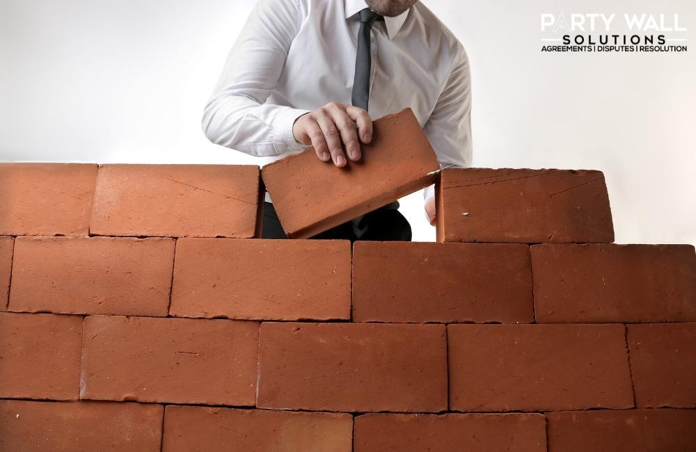 Do you have to be hired to be a party wall surveyor?